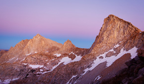 We stayed and watched the sun go from a blazing orange to a soft pink. As the mountains were awash in alpenglow, we strapped on our packs and headed to camp … or so we thought … (Chris Jordan-Bloch / Earthjustice)